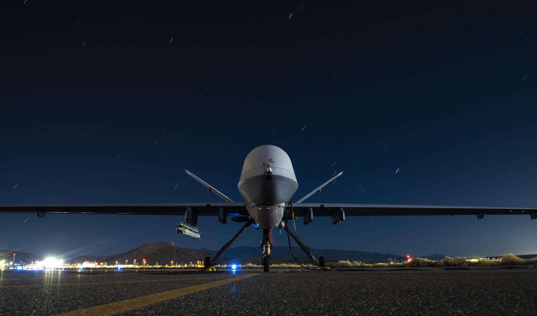 A U.S. Air Force MQ-9 Reaper assigned to the 556th Test and Evaluation Squadron armed with an AIM-9X Block 2 missile sits on the ramp at Creech Air Force Base, Nevada, Sept. 3, 2020. During the weapon test, aircrew successfully employed a live air-to-air AIM-9X Block 2 missile against a target BQM-167 drone simulating a cruise missile. (U.S. Air Force photo by Senior Airman Haley Stevens)