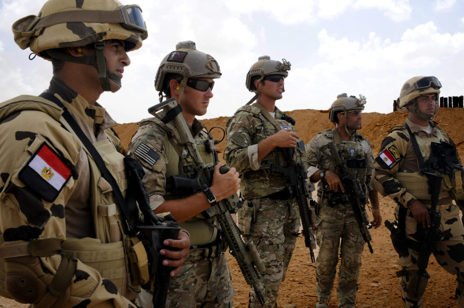 Egyptian and U.S. Special Operations Soldiers observe a small arms range, which was part of Exercise Bright Star. The exercise is held to promote and enhance regional security and cooperation between the seven participating nations, which include the Arab Republic of Egypt, the United States, Jordan, the Kingdom of Saudi Arabia, Greece, the United Kingdom, and France.