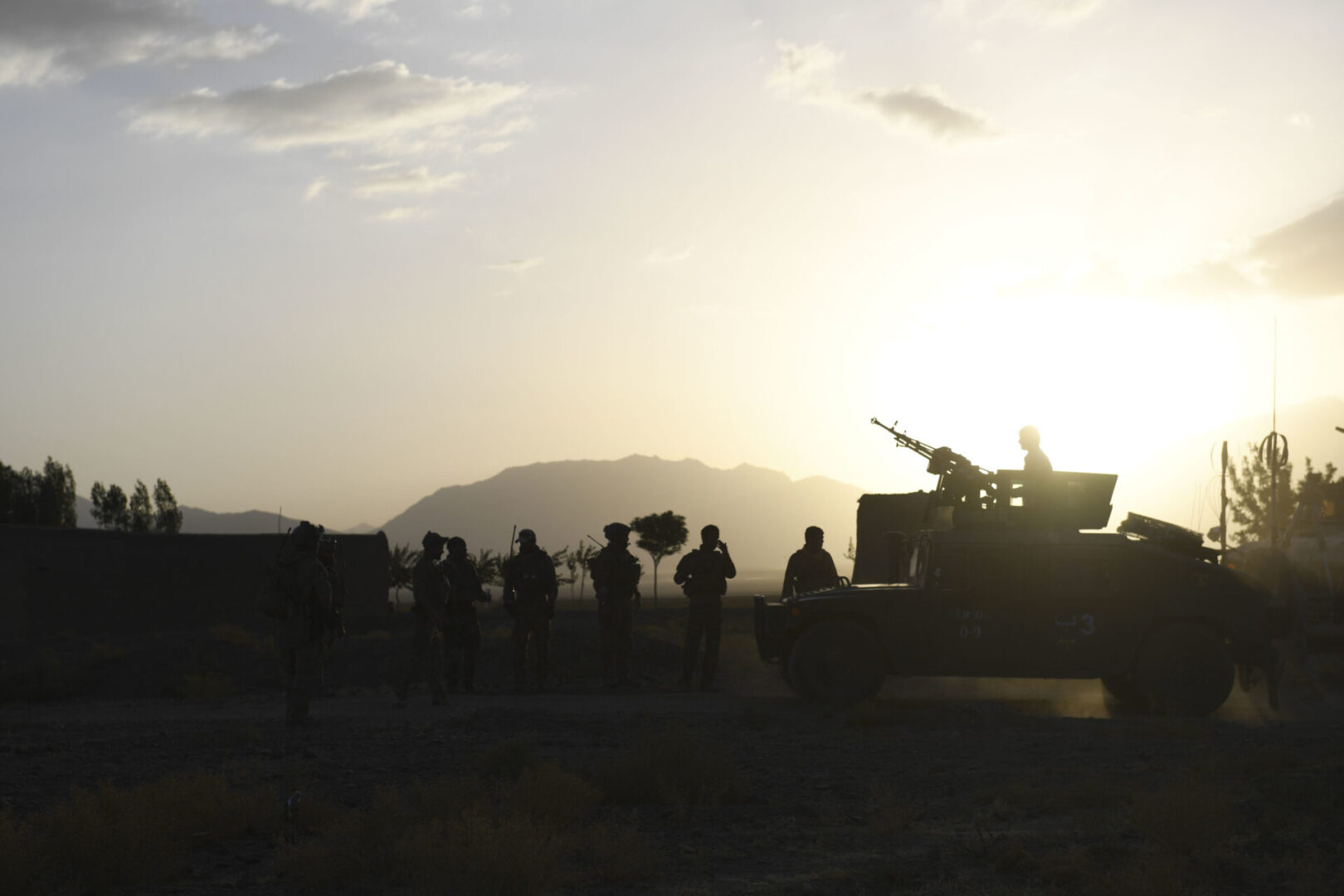 MOHAMMAD AGHA DISTRICT, Afghanistan (July 28, 2018) -- Afghan Special Security Forces and U.S. Special Operations soldiers enjoy a sunset in Mohammad Agha district, Logar province, Afghanistan, July 28, 2018. (U.S. Air Force photo by Staff Sgt. Nicholas Byers)